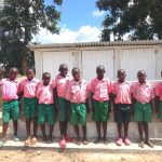The Water Project: Mwichina Primary School -  Boys Pose With Their New Latrines