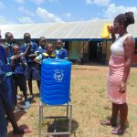 The Water Project: Mukama Primary School -  Showing Off A Leaky Tin For Handwashing