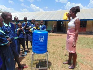 The Water Project:  Showing Off A Leaky Tin For Handwashing