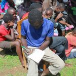 The Water Project: Malimali Community, Shamala Spring -  Participant Takes Notes