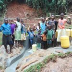The Water Project: Kisasi Community, Edward Sabwa Spring -  Community Members Celebrate The Spring