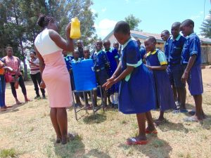 The Water Project:  Handwashing Practice Using A Leaky Tin