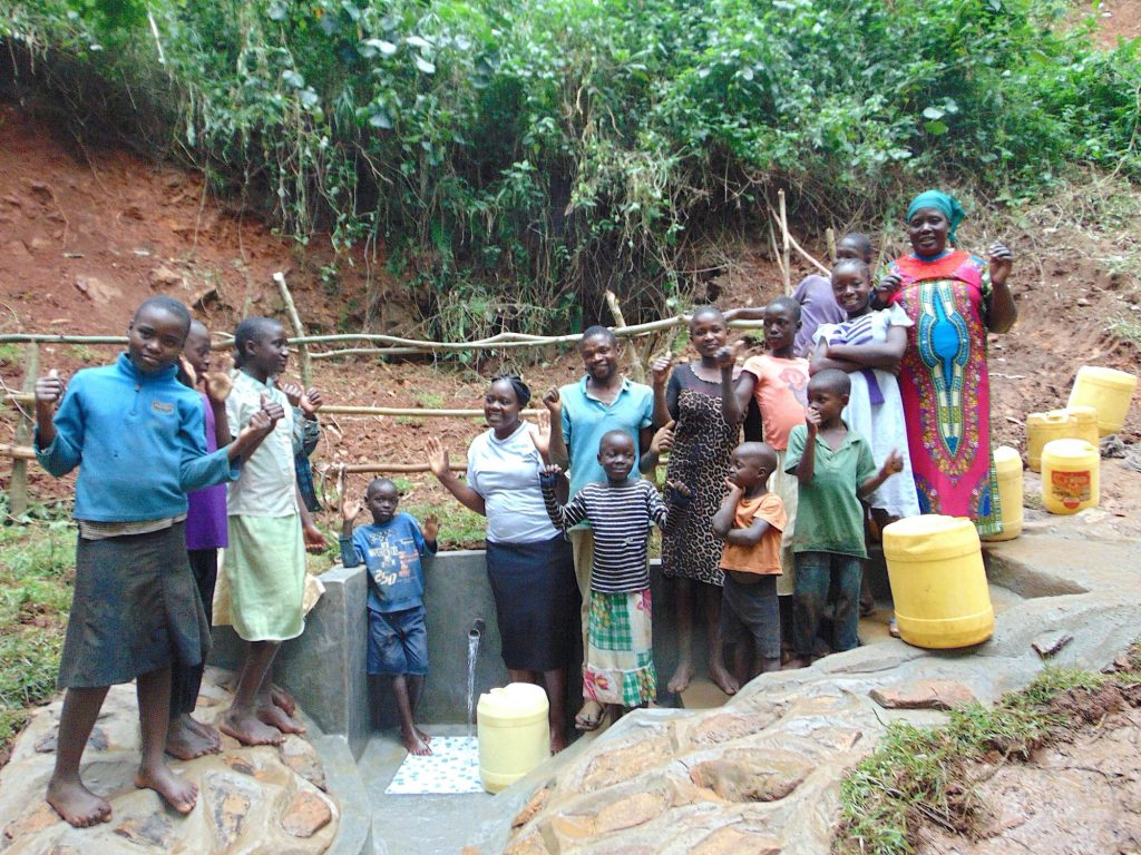 The Water Project : 34-kenya19164-community-members-celebrate-the-spring