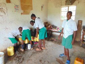 The Water Project:  Pupils Combine Water In A Pot