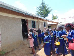 The Water Project:  Pointing Out The Gutter System To Students