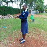 The Water Project: Kerongo Secondary School -  Student Demonstrates Handwashing