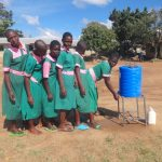 The Water Project: Mwichina Primary School -  Girls Use A Handwashing Station
