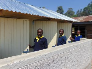 The Water Project:  Girls At Doors To Their New Latrines