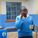 The Water Project: Kamimei Secondary School -  Pupil Bridgit Demonstrates Toothbrushing