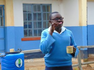 The Water Project:  Pupil Bridgit Demonstrates Toothbrushing