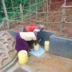 The Water Project: Jivovoli Community, Magumba Spring -  Women Fetching Water