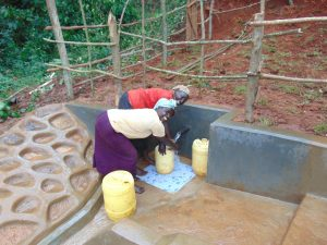 The Water Project:  Women Fetching Water