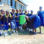 The Water Project: Kosiage Primary School -  Girls Use A Handwashing Station