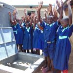 The Water Project: Mukama Primary School -  Students Celebrate Clean Water From The New Rain Tank