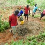 The Water Project: Malimali Community, Shamala Spring -  Mixing Concrete
