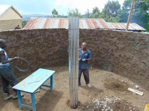 The Water Project:  Working On The Central Support Pillar