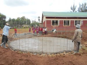 The Water Project:  Fitting Rebar Skeleton To Foundation