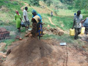 The Water Project:  Community Members Delivering Local Materials To Site