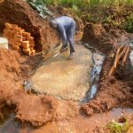 The Water Project: Shikhombero Community, Atondola Spring -  Laying Foundation