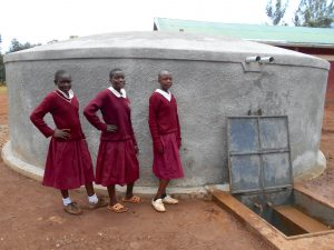 The Water Project:  Girls Pose With The Rain Tank
