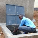 The Water Project: Banja Secondary School -  Student Enjoying Rain Tank Water