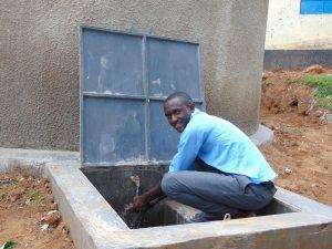 The Water Project:  Student Enjoying Rain Tank Water