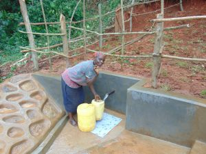 The Water Project:  Woman Fetching Water