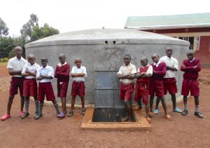 The Water Project:  Boys Pose With The Rain Tank