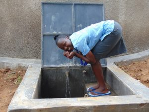 The Water Project:  Students Cups Fresh Rain Tank Water