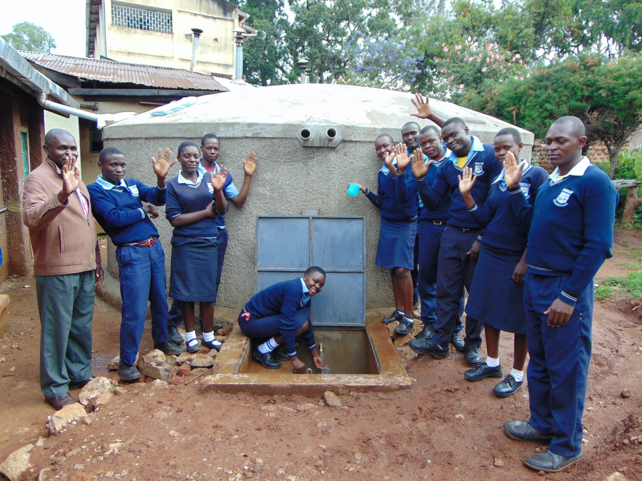 The Water Project : 42-kenya19289-students-and-staff-celebrate-the-new-tank