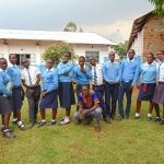 The Water Project: Kamimei Secondary School -  Students Pose With Trainer Samuel After Training
