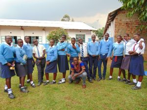The Water Project:  Students Pose With Trainer Samuel After Training