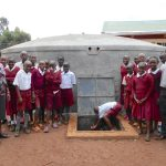 The Water Project: Ebukhuliti Primary School -  Students And Teachers Pose With The Rain Tank