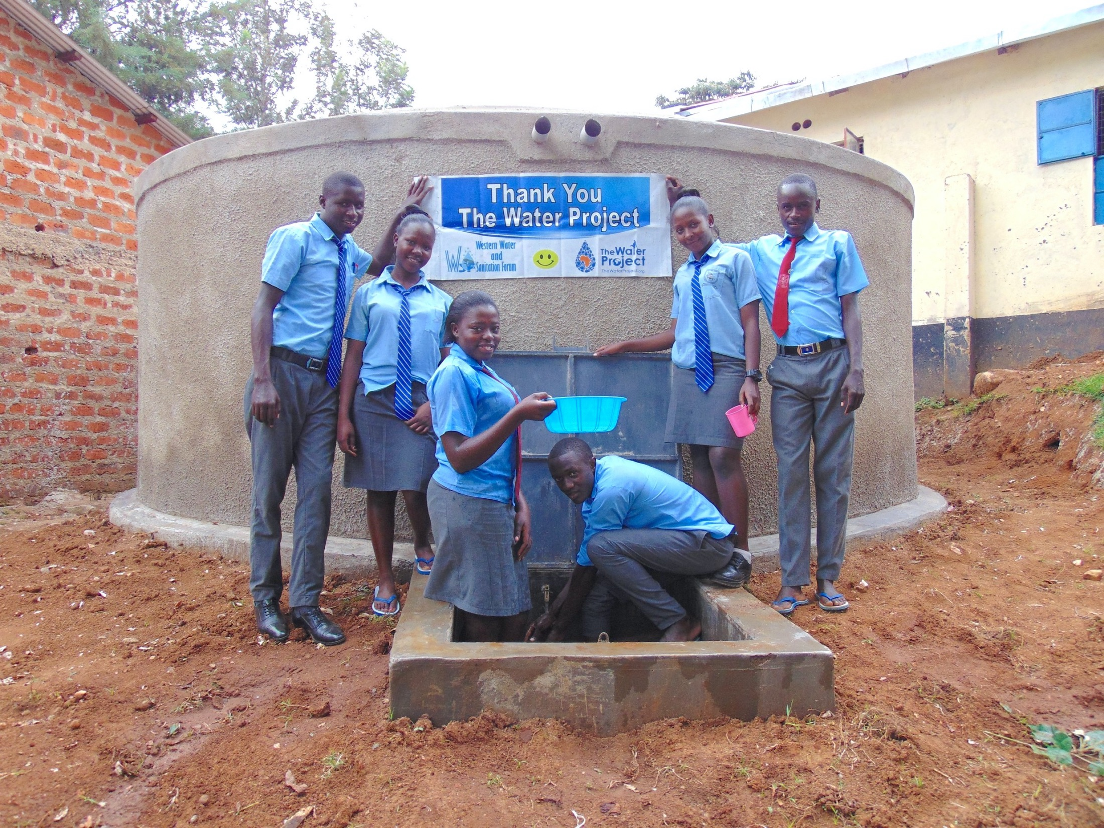 The Water Project : 45-kenya19064-students-pose-with-the-new-tank