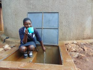 The Water Project:  Student Drinks Water From The Rain Tank
