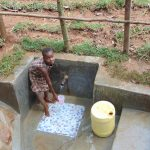 The Water Project: Shivembe Community, Murumbi Spring -  Getting A Fresh Drink