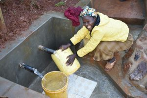 The Water Project:  Rinsing Containers And Fetching Water At The Same Time Is A Breeze