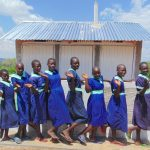 The Water Project: Mukama Primary School -  Girls Pose With New Latrines