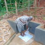 The Water Project: Jivovoli Community, Magumba Spring -  Thumbs Up For Clean Water