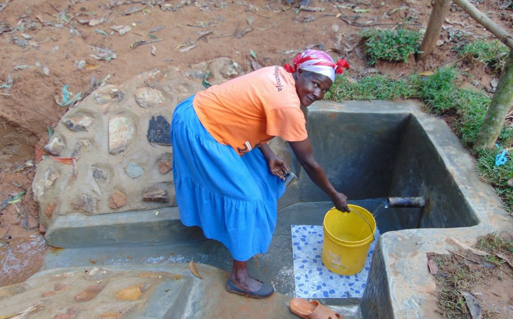 The Water Project : 48-kenya19167-happy-filling-up