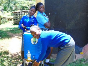 The Water Project:  Girls Use A Handwashing Station