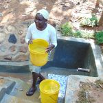 The Water Project: Shivembe Community, Murumbi Spring -  About To Mount Water On Her Head