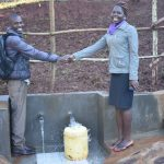 The Water Project: Busichula Community, Marko Spring -  Field Officers Shake Hands For A Job Well Done