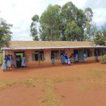 The Water Project: Saosi Primary School -  Students Outside Classrooms