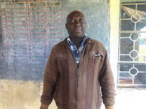 The Water Project:  Head Teacher Sir Joshua Lumwaji
