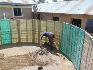 The Water Project:  Interior Rain Tank Cement Begins
