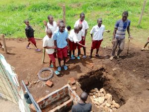 The Water Project:  Students Throw Stones Into Soak Pit