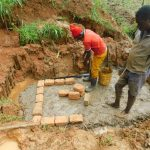 The Water Project: Malimali Community, Shamala Spring -  Brick Setting