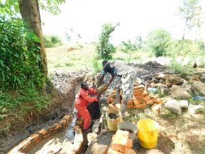 The Water Project:  Passing Stones To Artisan