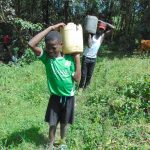The Water Project: Buyangu Community, Mukhola Spring -  Delivering Local Materials